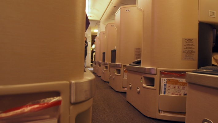A row of isolated business class seats with clean lines