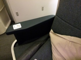 Raised armrest on Cathay Pacific New Business Class Seat