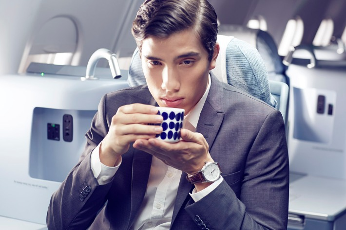 Finnair business man with teacup 01 Low