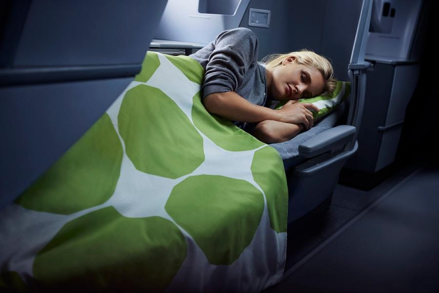 Finnair business woman sleeping 01 Low