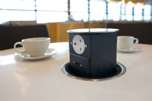 Pop-up power outlet in United Club, Heathrow T2