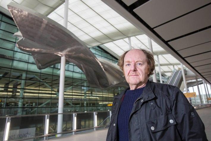 Richard Wilson with his sculpture Slipstream at Heathrow's new Terminal 2 The Queen's Terminal. Photograher David Levene