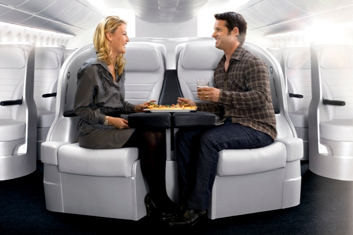 Premium-Economy-Couple-Dining-Together
