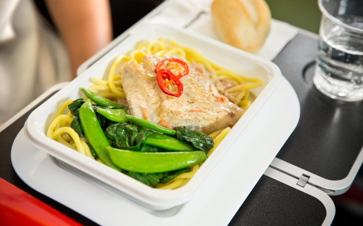 Barramundi poached in a lightly spiced coconut sauce with noodles, sugar snaps, choy sum and chilli
