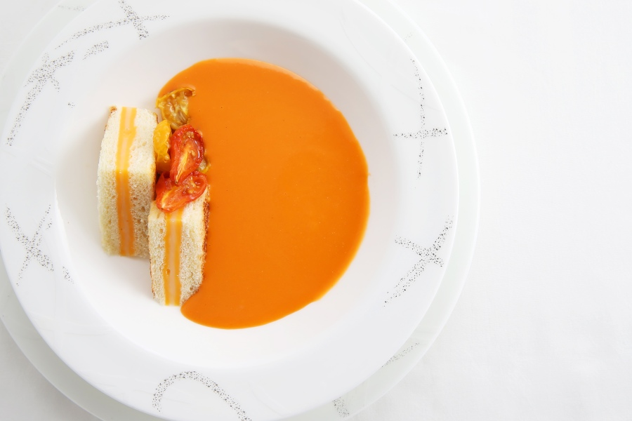 A soup of slow-roasted tomatoes with miniature grilled cheese sandwiches