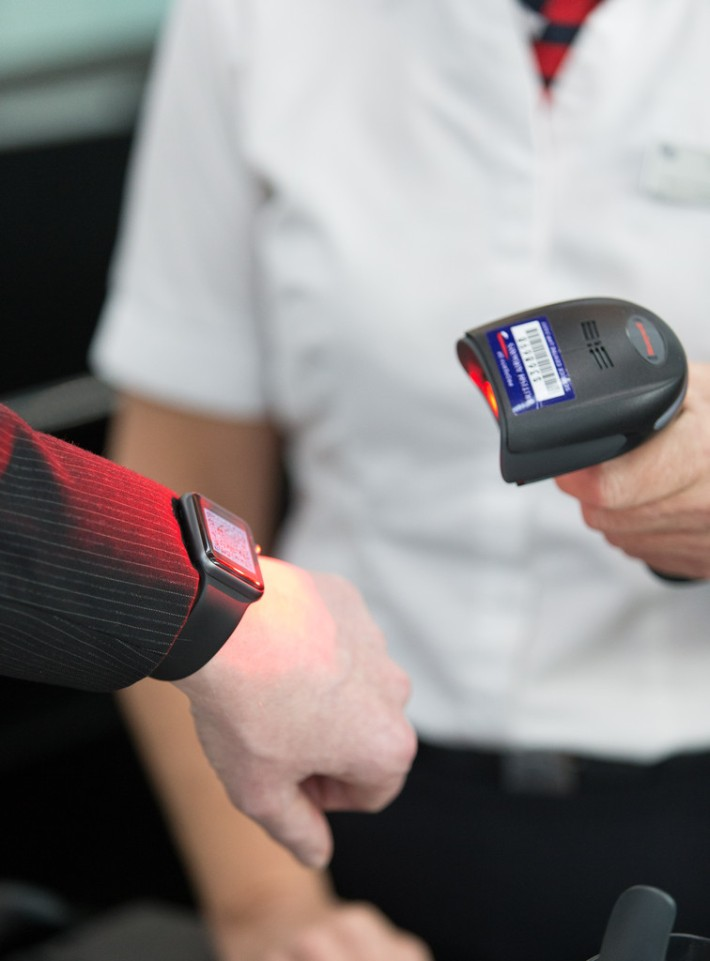 Apple Watch / Smartphone Scanner for Boarding Passes Taken: 27th November 2015 at Heathrow Terminal 5 British Airways Picture by: Stuart Bailey / British Airways
