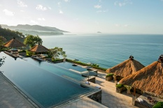 Amankila's three-tier pool is set into the cliff edge, offering spectacular panoramic views of Amuk Bay and Nusa Penida. The aqua-tiled pools flow one into the other, stepping down like terraced rice fields
