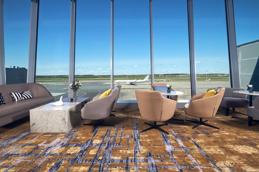 Plaza Premium Lounge Helsinki - relaxation area overlooking runways