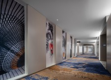 Aerotel Beijing - guestroom corridor featuring cultural images