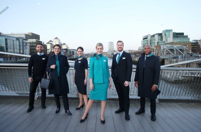 NO REPRO FEE 15/01/2019 Aer Lingus New Look Uniform. Pictured are Aer Lingus Cabin Crew members (l to r) Oisin Leong, Guest Experience Instructor; Aoife Costello, Cabin Service Manager; Eszter Dornfeld, Cabin Crew; Vicoria Elmore, Senior Cabin Crew; David Rodgers, Senior Cabin Crew and Byron Kumbula, Senior Cabin Crew pictured at the unveiling of Aer Lingus' new look uniform designed by Louise Kennedy. The new design will be worn by over 4,000 cabin and ground crew around the world from February 10th. Notable changes to the uniform include the addition of trouser and dress options for female crew, new jacket and coat designs for male crew, and easy-care shirts and blouses for the convenience of all crew. Photograph: Leon Farrell / Photocall Ireland