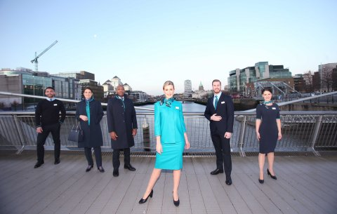 NO REPRO FEE 15/01/2019 Aer Lingus New Look Uniform. Pictured are Aer Lingus Cabin Crew members (l to r) Oisin Leong, Guest Experience Instructor; Aoife Costello, Cabin Service Manager; Byron Kumbula, Senior Cabin Crew; Vicoria Elmore, Senior Cabin Crew; David Rodgers, Senior Cabin Crew and Eszter Dornfeld, Cabin Crew, pictured at the unveiling of Aer Lingus' new look uniform designed by Louise Kennedy. The new design will be worn by over 4,000 cabin and ground crew around the world from February 10th. Notable changes to the uniform include the addition of trouser and dress options for female crew, new jacket and coat designs for male crew, and easy-care shirts and blouses for the convenience of all crew. Photograph: Leon Farrell / Photocall Ireland