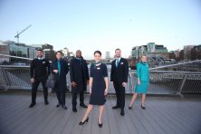NO REPRO FEE 15/01/2019 Aer Lingus New Look Uniform. Pictured are Aer Lingus Cabin Crew members (l to r) Oisin Leong, Guest Experience Instructor; Aoife Costello, Cabin Service Manager; Byron Kumbula, Senior Cabin Crew; Eszter Dornfeld, Cabin Crew David Rodgers, Senior Cabin Crew and Vicoria Elmore, Senior Cabin Crew, pictured at the unveiling of Aer Lingus' new look uniform designed by Louise Kennedy. The new design will be worn by over 4,000 cabin and ground crew around the world from February 10th. Notable changes to the uniform include the addition of trouser and dress options for female crew, new jacket and coat designs for male crew, and easy-care shirts and blouses for the convenience of all crew. Photograph: Leon Farrell / Photocall Ireland