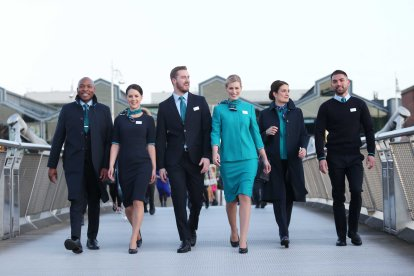 NO REPRO FEE 15/01/2019 Aer Lingus New Look Uniform. Pictured are Aer Lingus Cabin Crew members (l to r) Byron Kumbula, Senior Cabin Crew; Eszter Dornfeld, Cabin Crew; David Rodgers, Senior Cabin Crew; Vicoria Elmore, Senior Cabin Crew; Aoife Costello, Cabin Service Manager, and Oisin Leong, Guest Experience Instructor pictured at the unveiling of Aer Lingus' new look uniform designed by Louise Kennedy. The new design will be worn by over 4,000 cabin and ground crew around the world from February 10th. Notable changes to the uniform include the addition of trouser and dress options for female crew, new jacket and coat designs for male crew, and easy-care shirts and blouses for the convenience of all crew. Photograph: Leon Farrell / Photocall Ireland
