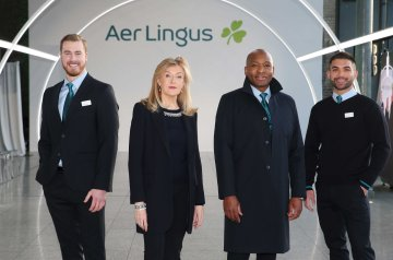 NO REPRO FEE 15/01/2019 Aer Lingus New Look Uniform. Designer Louise Kennedy pictured with Aer Lingus cabin crew (left to right) David Rodgers, Byron Kumbula and Oisin Leong at the unveiling of the new look Aer Lingus uniform. The new design reflects Aer Lingus' status as a modern international airline with a proud Irish heritage and is the final stage in the airline's brand refresh which commenced in early 2019. Guests flying with Aer Lingus in the coming months can expect to still see the iconic green, now dubbed 'Kenmare Green', as well as a greater inclusion of navy colour 'Midnight' throughout. Photograph: Leon Farrell / Photocall Ireland