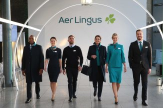 NO REPRO FEE 15/01/2019 Aer Lingus New Look Uniform. Designer Louise Kennedy pictured with Aer Lingus cabin crew (left to right)Byron Kumbula, Senior Cabin Crew; Eszter Dornfeld, Cabin Crew; Oisin Leong, Guest Experience Instructor; Aoife Costello, Cabin Service Manager; Vicoria Elmore, Senior Cabin Crew; David Rodgers, Senior Cabin Crew, at the unveiling of the new look Aer Lingus uniform. The new design reflects Aer Lingus' status as a modern international airline with a proud Irish heritage and is the final stage in the airline's brand refresh which commenced in early 2019. Guests flying with Aer Lingus in the coming months can expect to still see the iconic green, now dubbed 'Kenmare Green', as well as a greater inclusion of navy colour 'Midnight' throughout. Photograph: Leon Farrell / Photocall Ireland